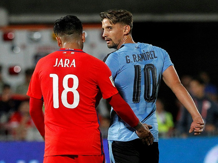 Chile's Gonzalo Jara (L) and Uruguay's Gaston Ramirez during their 20